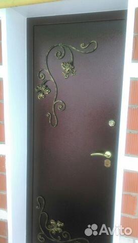металлические двери с кованным декором